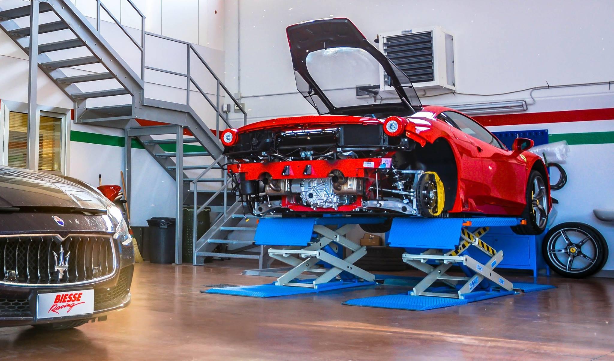 Biesse racing Ferrari on a lift