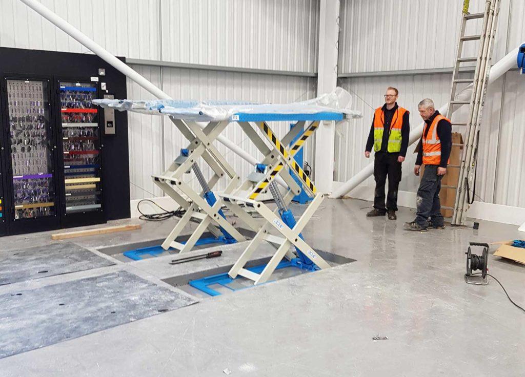 scissor lift installation in progress in the Hippo Motor Group facility