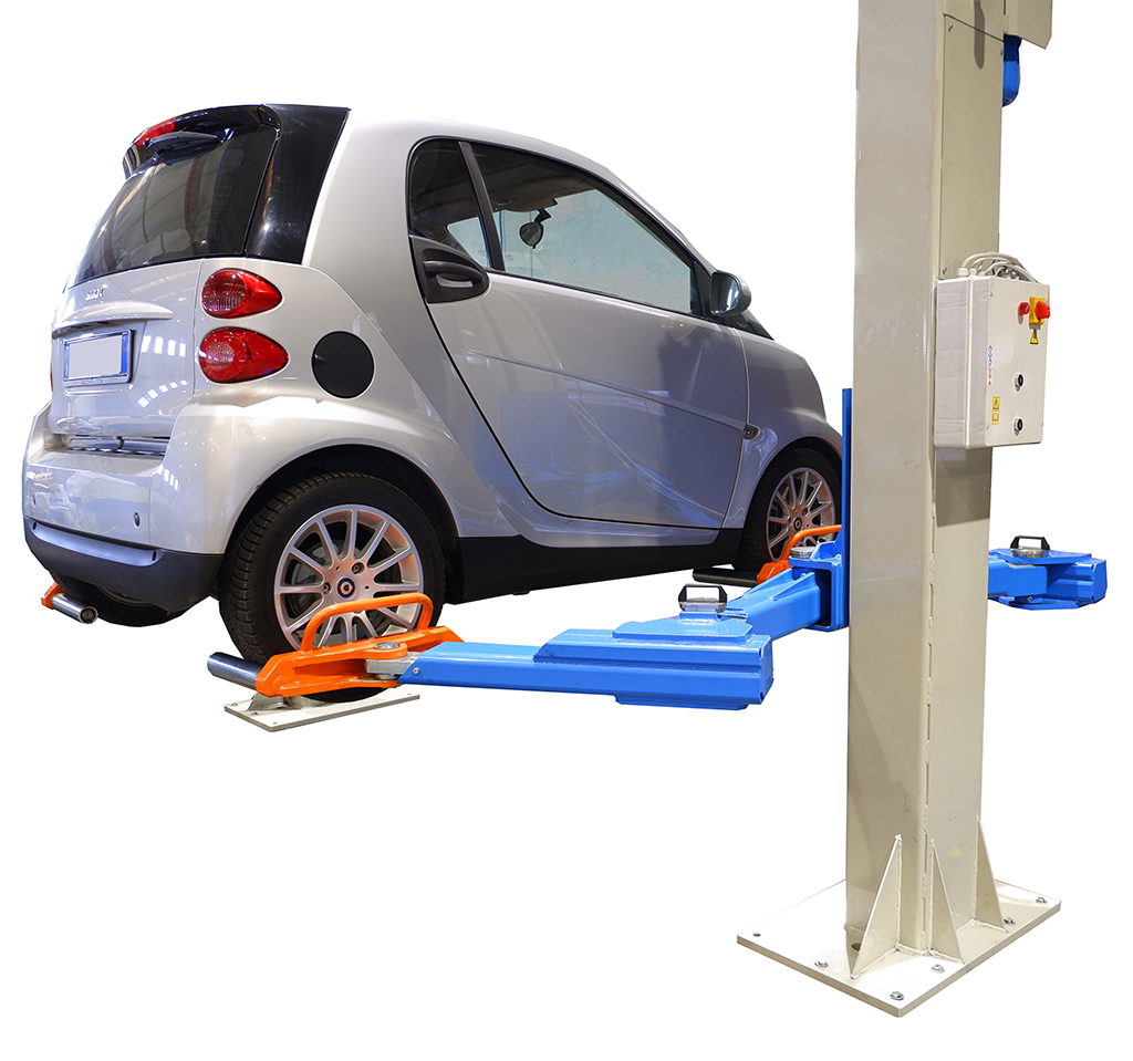 a small electric car lifted by an OMCN car lift for garages