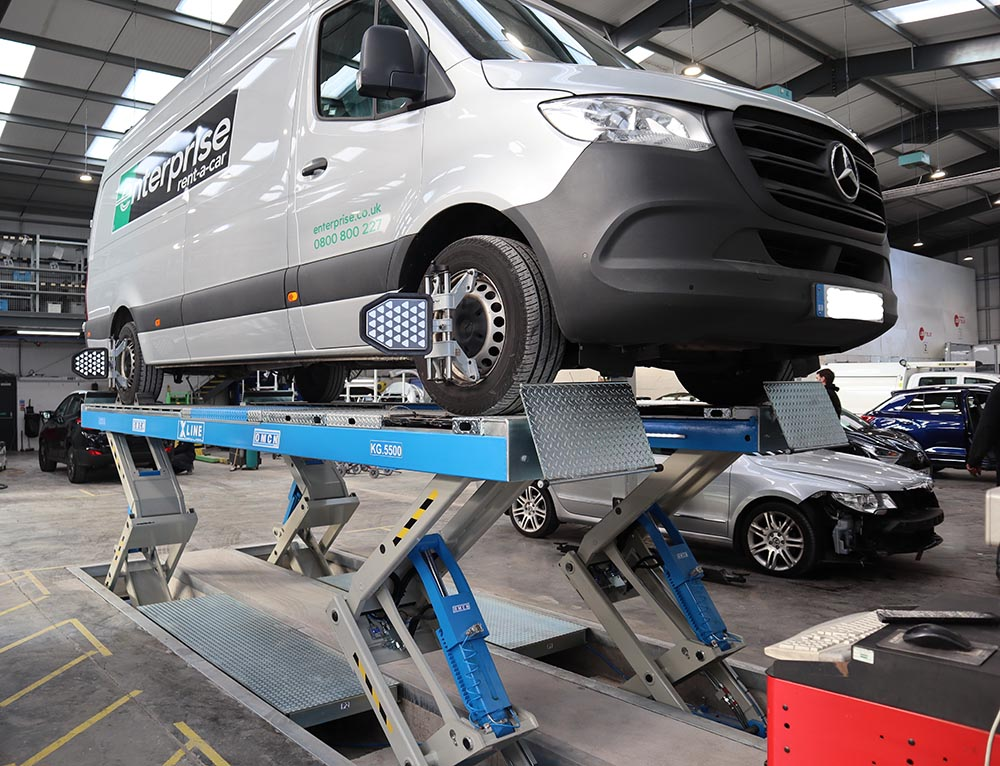 a van on an xlin lift installed by auto-tools for Fylde accident repair
